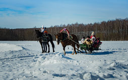 26 February 2017 the Holiday of Maslenitsa in Borodino. The annual celebration that marks the end of winter and arrival of spring. People having fun, eating stock photo