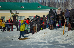 26 February 2017 the Holiday of Maslenitsa in Borodino. The annual celebration that marks the end of winter and arrival of spring. People having fun, eating stock photography