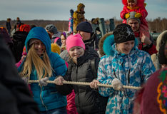 26 February 2017 the Holiday of Maslenitsa in Borodino. The annual celebration that marks the end of winter and arrival of spring. People having fun, eating royalty free stock photo