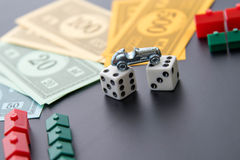 February 8, 2015: Houston, TX, USA.  Monopoly car, dice, money, Stock Photo