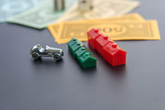 February 8, 2015: Houston, TX, USA.  Monopoly car, dice, money, Stock Images