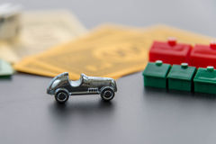 February 8, 2015: Houston, TX, USA.  Monopoly car, dice, money, Royalty Free Stock Photo