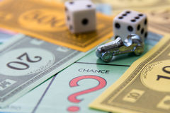 February 8, 2015: Houston, TX, USA.  Monopoly game board with ca. Monopoly game board with car on Chance Stock Photos