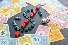 February 8, 2015: Houston, TX, USA.  Monopoly money around house Royalty Free Stock Photos