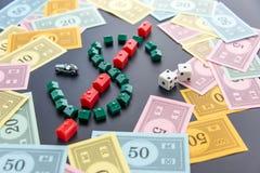 February 8, 2015: Houston, TX, USA.  Monopoly money around house Royalty Free Stock Photos