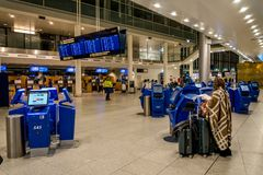 February 18, 2019. Kastrup Airport Denmark Copenhagen. Woman backs unrecognizable with large suitcases baggage independently. Checking in electronic ticket stock photos