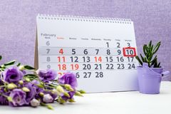 February 10 mark on the calendar. On purple background stock photography