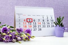 February 5 mark on the calendar. On purple background stock image