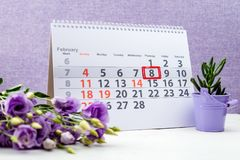 February 8 mark on the calendar. On purple background stock photos
