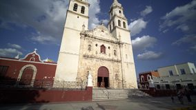 Campeche Unesco World Heritage colonial city. February 27, 2017 Mexico, Campeche. moving shot,walking near central church, Campeche Unesco World Heritage stock video footage