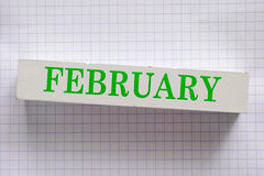 February. Month printed on wooden block Stock Image