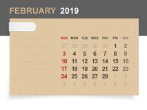 February 2019 - Monthly calendar on brown paper and wood background. Royalty Free Illustration
