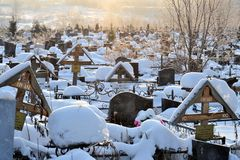 Crosses in a cemetery, monuments of the dead, a cemetery in winter, wreaths, artificial flowers. Russia. February 23, 2018 Moscow region Crosses in a cemetery stock photo