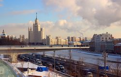 View of the floating bridge with visitors attractions. 01 February 2018, Moscow, Russia, View of the floating bridge with visitors attractions and the skyscraper Royalty Free Stock Image