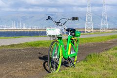 February 17, 2019 Mountain View / CA / USA - Lime bike left on the bay trail in south San Francisco bay area stock image