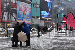 9 February 2017 - New York City, NY: Tourist taking selfie in Times Square at the day that winter storm Niko hits New York City. New York City, NY: Tourist Royalty Free Stock Image
