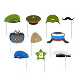 23 February Photo props. National holiday in Russia. Defender of. Fatherland day. Military hat and peakless Cap. Hats soldiers. Green and blue beret. Mustache Stock Photos