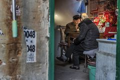 Residents in the old town. In February 2017, residents of the old city of Nanjing, China, are chatting in the neighborhood stock photos