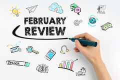 February Review concept. Hand with marker writing Royalty Free Stock Photography