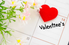 February 14 of Saint Valentines day. Calendar page with the red hearts on February 14 of Saint Valentines day Royalty Free Stock Image