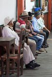 Men sitting inside a bar in Salento Colombia. February 20, 2017 Salento, Colombia: men sitting inside a bar in the famous coffee region town royalty free stock photography