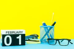 February 1st. Day 1 of february month, calendar on teacher or some manager workplace background. Winter time.  Stock Photo