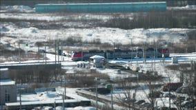 Powerful  locomotive aerial view tilt film. February  28, 2018 St. Petersburg, Russian Railways powerful  locomotive aerial view tilt film stock video