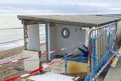 February 14 Storm Damage 2014, concrete beach huts damaged, Milf Stock Photo