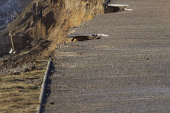 February 14 Storm Damage 2014, holes gauged out of tarmac asphal Royalty Free Stock Photography