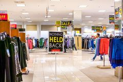 February 28, 2019 Sunnyvale / CA / USA - Indoor view of the women`s clothes department at a Macy`s store about to close; signs. Advertising high discounts stock photos