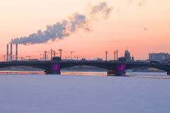 The February sunset over the Annunciation Bridge. Saint-Petersburg, Russia Royalty Free Stock Image