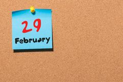 February 29th. Calendar for februar 29 on cork notice board background. empty space. Leap year, intercalary day.  Royalty Free Stock Image