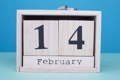 February 14th calendar with wedding rings. Valentines Day wooden date. Valentine`s Day Offer stock images