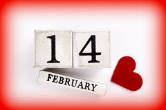 February 14th Calendar. February 14th wooden calendar and heart, Valentine`s day Royalty Free Stock Image