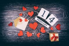 February 14th Calendar. February 14th wooden calendar and heart, Valentine`s day Stock Photography