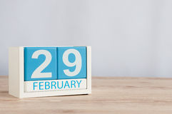 February 29th. Cube calendar for february 29 on wooden surface with empty space For text. Leap year, intercalary day.  Stock Image