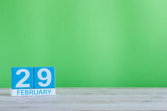 February 29th. Cube calendar for february 29 on wooden workplace with with green background and empty space For text. February 29th. Cube calendar for february Royalty Free Stock Photography