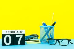 February 7th. Day 7 of february month, calendar on yellow background with office supplies. Winter time.  stock photo