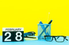 February 28th. Day 28 of february month, calendar on yellow background with office supplies. Winter time.  stock image