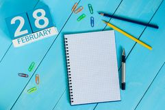 February 28th. Day 28 of month, calendar on wooden background. Winter at work concept. Empty space for text Stock Image