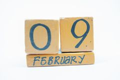 February 9th. Day 9 of month, handmade wood calendar isolated on white background. Winter month, day of the year concept. February 9th. Day 9 of month, handmade royalty free stock photography
