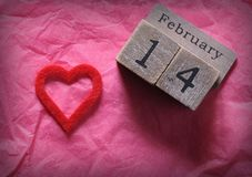 February 14th and red cut heart on pink paper Royalty Free Stock Photos