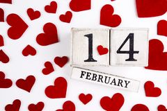 February 14th Calendar. February 14th wooden calendar and heart, Valentine`s day Royalty Free Stock Photography