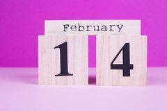 February 14th wooden calendar. Valentines Day wooden date. Reminder about the February gift stock image