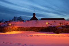 February twilight at the walls of the ancient fortress Korela. Priozersk, Russia Royalty Free Stock Photo