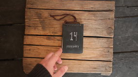 14 February or Valentine`s Day idea. 14 February Valentine`s Day idea. Calendar on vintage table stock footage
