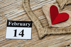 February 14 Valentines day - heart from red paper. February 14, on the calendar, Valentine's day, heart from red paper Royalty Free Stock Image