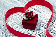 February 14 Valentines day - heart from red ribbon. February 14, giftbox, Valentine's day, heart from red ribbon Royalty Free Stock Photo