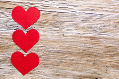 February 14 Valentines day - hearts from red paper. February 14, Valentine's day, hearts from red paper on wooden background Royalty Free Stock Image