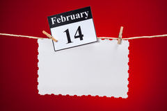 February 14 Valentines day. February 14, Valentine's day, white vintage paper over red background Stock Images